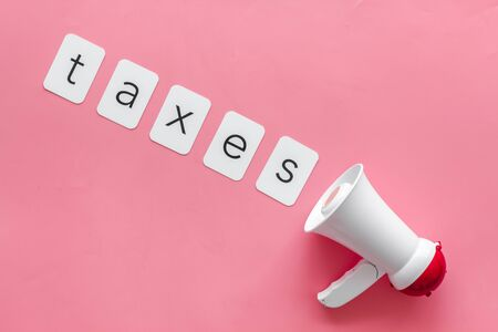 Photo pour Taxes announcement with megaphone and text on pink background top view - image libre de droit