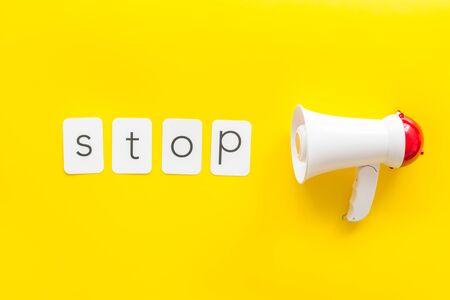 Photo pour Stop announcement symbol with megaphone and text on stop background top view - image libre de droit