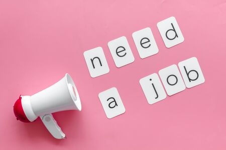 Photo pour Need a job announcement symbol with megaphone and text on pink background top view - image libre de droit