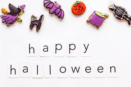 Foto de Happy halloween copy and cookies for decoration on white background top view - Imagen libre de derechos