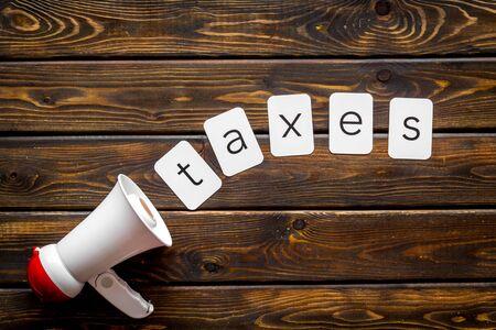 Photo pour announce with taxes copy and megaphone on wooden background top view - image libre de droit