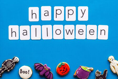 Foto de Happy halloween copy and cookies for decoration on blue background top view - Imagen libre de derechos