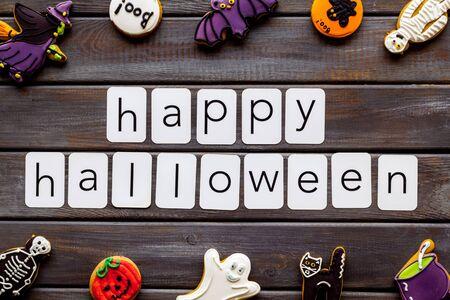 Foto de Happy halloween copy and cookies for decoration on wooden background top view - Imagen libre de derechos