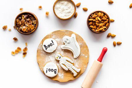 Foto de Cook halloween gingerbread cookies on white background top view - Imagen libre de derechos