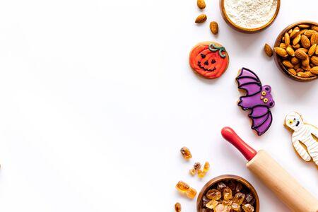 Foto de spooky halloween figures with rolling pin, flour, sugar, almond for cooking treat on white background top view mock up - Imagen libre de derechos