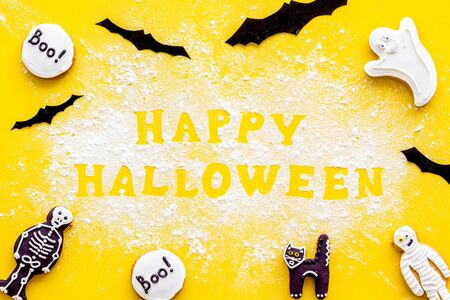 Foto de Frame from halloween figures around happy halloween copy from flour on yellow background top view - Imagen libre de derechos