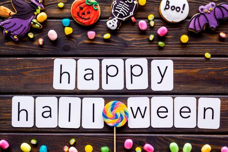 Foto de Frame from Halloween figures around happy Halloween copy on wooden background top view - Imagen libre de derechos
