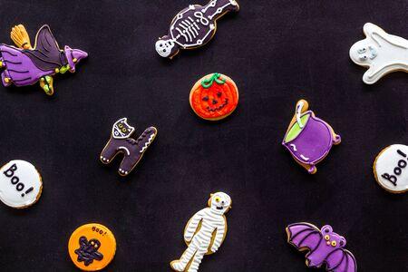 Foto de Halloween cookies in shape of spooky figures pattern on black background top view - Imagen libre de derechos