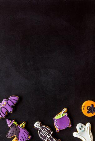 Foto de Creepy cookies for halloween treat frame on black background top view mockup - Imagen libre de derechos