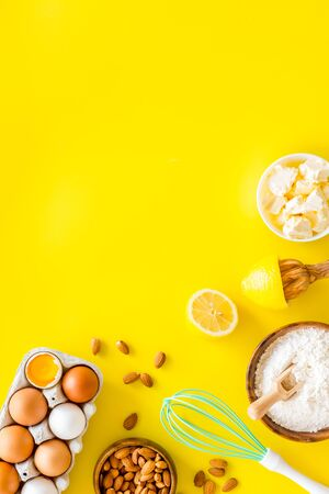 Photo for Baking background. Dough ingredients on yellow background top view space for text - Royalty Free Image