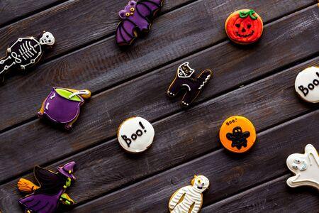 Foto de Celebration halloween and party decorations. Creepy cookies for halloween treat pattern on wooden background top view - Imagen libre de derechos