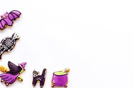 Foto de Celebration halloween and party decorations. Creepy cookies for halloween treat frame on white background top view mockup - Imagen libre de derechos