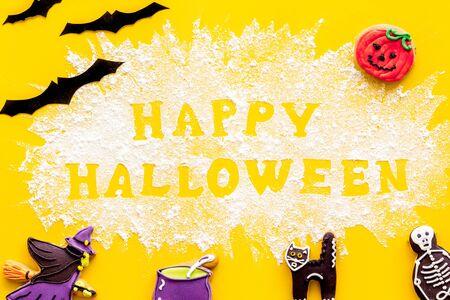 Foto de Decoration for party. Frame from halloween figures around happy halloween copy from flour on yellow background top view - Imagen libre de derechos