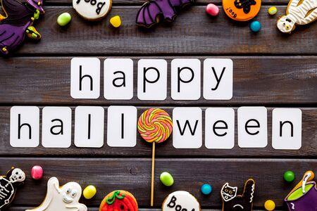 Foto de Halloween cookies frame in shape of spooky mystic figures and characters with happy halloween copy on wooden background top view - Imagen libre de derechos