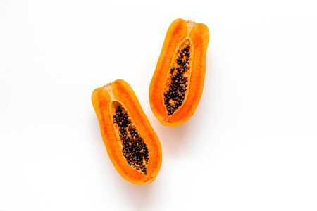 Photo for Ripe juicy papaya on white background top view copy space - Royalty Free Image