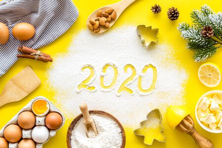 Photo for Happy New Year concept. 2020 written on yellow baking background top view - Royalty Free Image