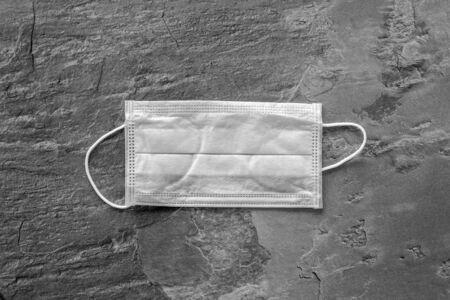 Photo pour Flu prevention concept. Medical face mask on grey background top view copy space - image libre de droit
