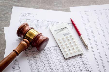 Foto de Bankruptcy concept. Judge hammer near financial documents on grey background. - Imagen libre de derechos