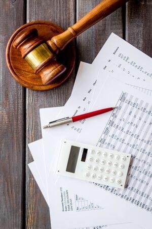 Foto de Bankruptcy concept. Judge hammer near financial documents on dark wooden background top view - Imagen libre de derechos