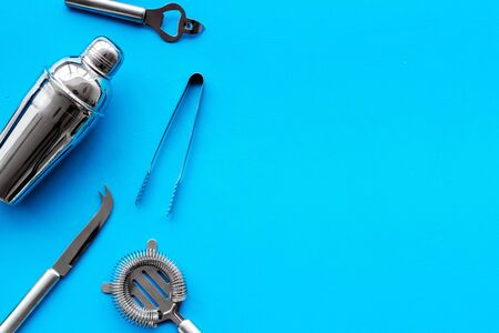 Photo pour Bar utensil, tools - shaker, stainer - on blue background top-down frame. - image libre de droit