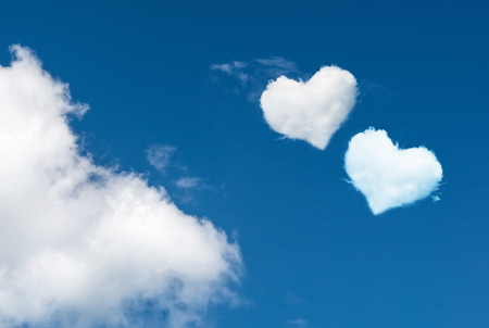 Photo pour blue sky with hearts shape clouds. Love concept - image libre de droit