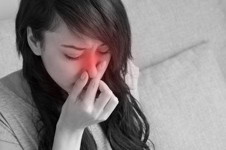Foto de sick woman suffers from flu, cold, running nose, asian caucasian indoor scene - Imagen libre de derechos