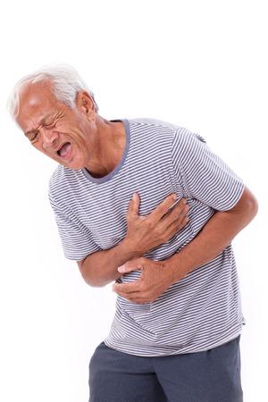 Foto de sick old man suffering from heart attack or breathing difficulties - Imagen libre de derechos