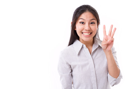 Foto de happy woman showing 3 fingers gesture - Imagen libre de derechos