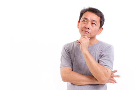 Photo for middle aged asian man thinking, studio isolated portrait - Royalty Free Image