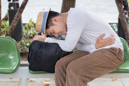 Foto de sick man traveler with nausea, stomachache, vomit, acid reflux - Imagen libre de derechos
