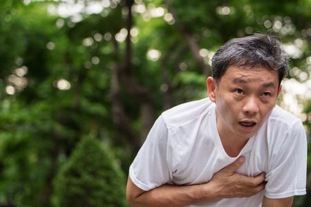 Foto de exhausted, panting, cardiac arrest running senior man, outdoor park - Imagen libre de derechos