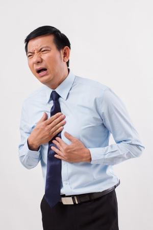 Foto de sick man suffering from acid reflux, gerd, heartburn, indigestion - Imagen libre de derechos