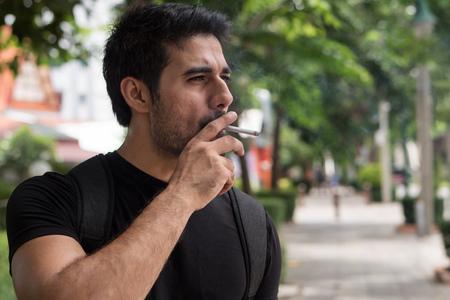 Photo pour Asian man smoker smoking cigarette - image libre de droit