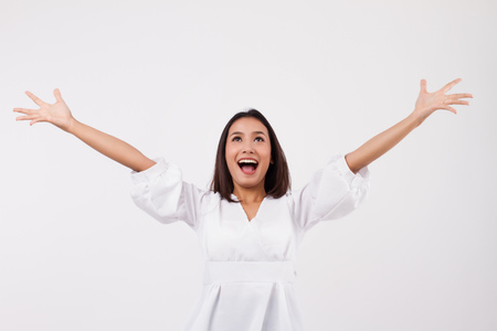 Photo for excited asian woman looking up - Royalty Free Image