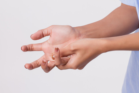 Photo for Woman suffering from trigger finger, cps, wrist joint pain, arthritis, gout - Royalty Free Image