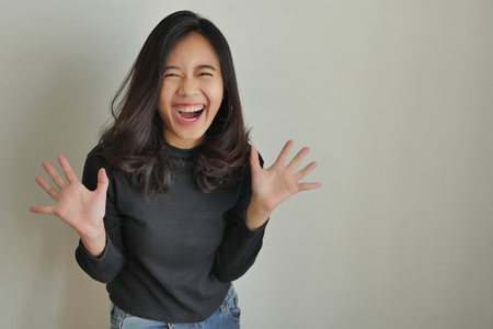 Foto de happy excited asian woman laughing - Imagen libre de derechos