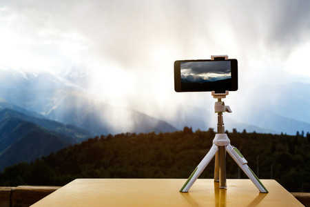 Photo for smartphone on a tripod in the mountains, a storm against the background - Royalty Free Image