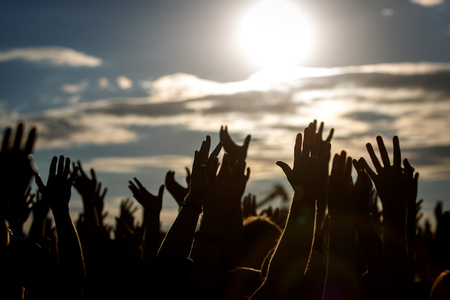 Photo pour People silhouettes with raised up a human hands, Beach Party Summer Holiday Vacation Concept - image libre de droit
