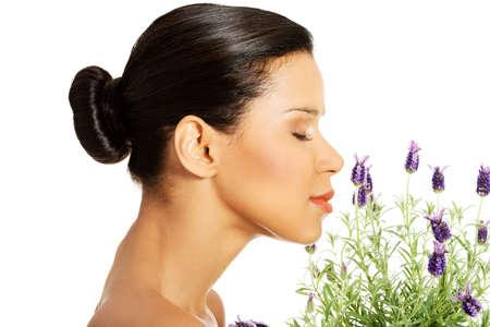 Foto de Beautiful girl smell purple lavender flowers - Imagen libre de derechos