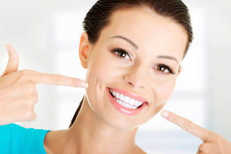 Photo for Woman showing her perfect straight white teeth.  - Royalty Free Image