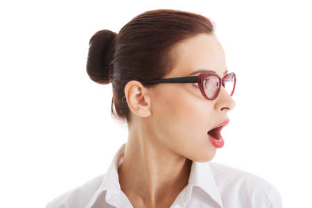 Profile of shocked, surprised woman in eyeglasses. Isolated on white.