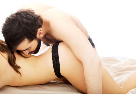 Photo pour Young beautiful couple having foreplay in bedroom. - image libre de droit