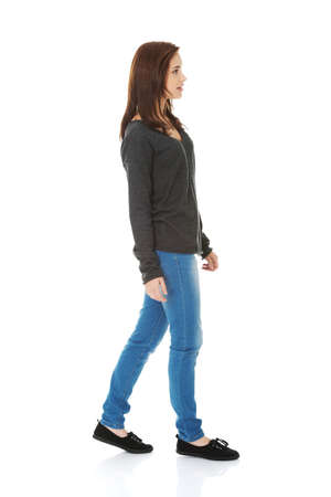 Photo for Young beautiful woman walking smiling - Royalty Free Image