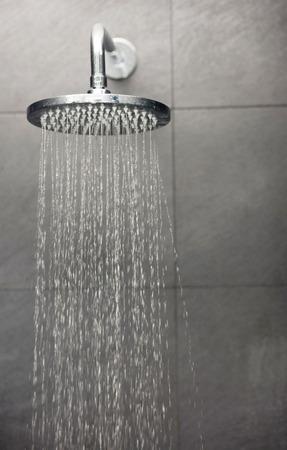 Photo pour Shower head with water stream. - image libre de droit