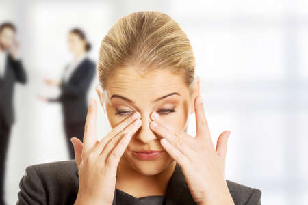 Photo for Stressed businesswoman suffering from eyes pain. - Royalty Free Image