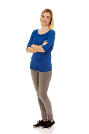 Photo for Casual woman with arms crossed smiling. - Royalty Free Image