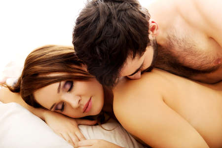 Photo pour Young love couple in bed, romantic scene in bedroom. - image libre de droit