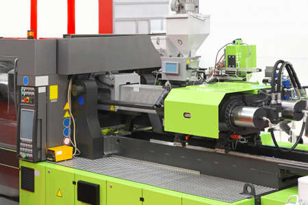 Foto de Injection moulding machine for plastic parts production - Imagen libre de derechos