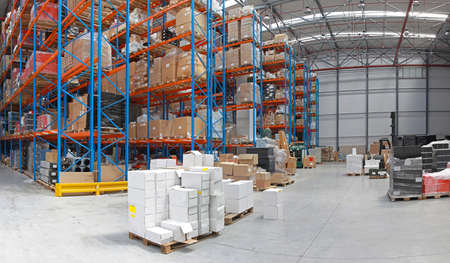 Photo for Distribution centre with high rack shelving system - Royalty Free Image