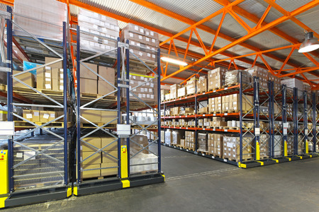 Photo for Mobile roller shelving system in distribution warehouse - Royalty Free Image